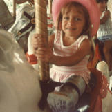Jen taking a spin on the merry go round.
