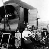 In this photo taken around 1900, gypsies in Paris pose by their caravan.
