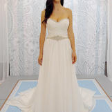 This white strapless wedding gown reads 'Greek goddess' with its artful folds and airy fabric.
