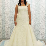 This lace ivory gown with cap sleeves looks great against olive skin.