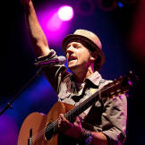 Musician Jason Mraz writes upbeat tunes. He and his friends want Kat t