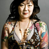 Comedian Margaret Cho wants an art nouveau peacock tattoo from Kat. Margaret loves peacocks and believes they are a symbol of beauty.