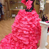 The pink cancan-style skirt is detachable.