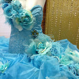 Dyed ostrich feathers adorn the bodice of Eden's wedding gown.
