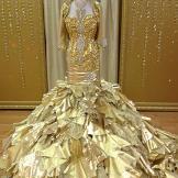 Kayla's 24-karat gold dress comes with a matching bolero jacket.