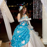 A queen of hearts makes a grand entrance at the Valentine's Day Ball.