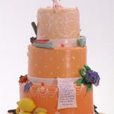Team Ashley and Gretel-Ann created this bright peach cake with symbols