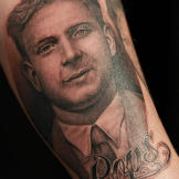 Tim tattoos a portrait of John's father to memorialize his burger join