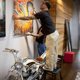 Billy DeCola hanging shop art.