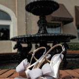 Miranda wore these lavender Badgley Mischka shoes beneath her wedding