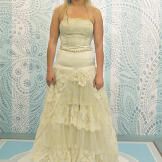 "After Kelly's transformation, some volume was gone from the skirt, and a dropped waist with crystal belt emphasized the bride's figure. ""I had no idea this dress had any potential at all,"" Courtney said of the"