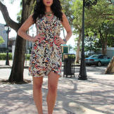 This wrap dress is fun and flirty with its multitude of vibrant colors