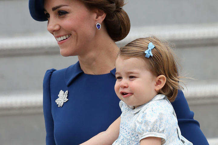 Duchess Catherine holding Princess Charlotte in Canada