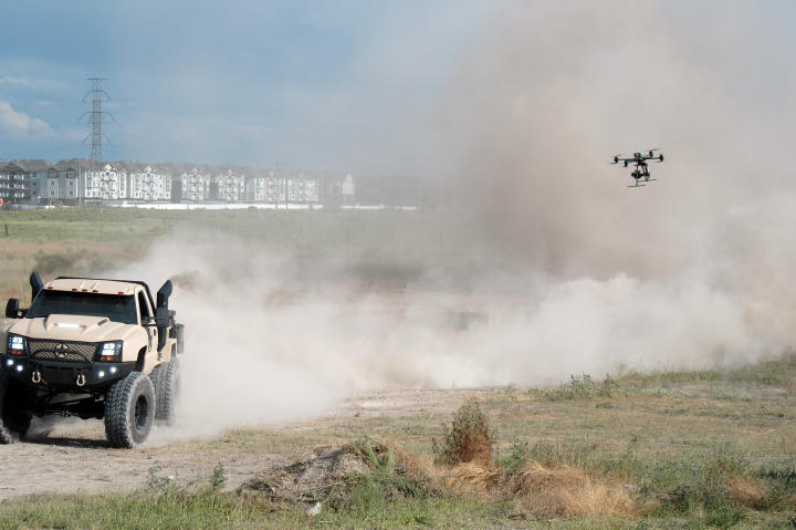 An aerial drone follows along the completed Duramax kicking up some dust!