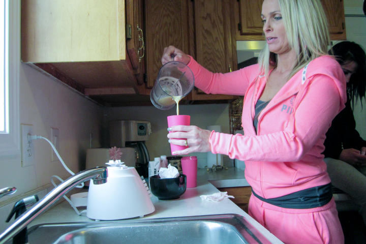 Even if you're just hanging around the house, you should still make an effort. Nettie rocks a hot pink track suit with a charcoal tee. Amp up your sexy factor by choosing a t-shirt made of fine-gauge cotton that will cling to your every curve. As for what you do in your loungewear, well, that's for you to decide. Nettie's making her