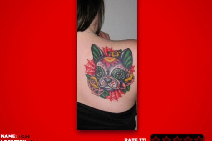 19. I am personally fond of sugar skull and Day of the Dead styled tattoos. I really like the creativity in making a sugar skull of her furry friend.