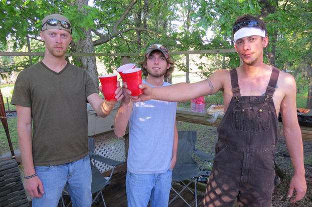 """Chris """"Flip"""" Woodall, Lathan Shivers and Dustin """"Duck"""" Campbell cheers to their new home in the bayou."""