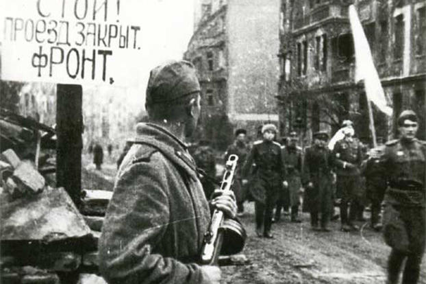 Delegation of German officers walking for negotiations before capitulation of Festung Breslau, May 6th, 1945. The Russian siege of Breslau had lasted three months. The sign reads
