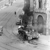 An M4 tank burns at the intersection of Karl Heine Str. and Zschochersche Str. in Leipzig, Germany, near the end of the war in Europe, 18 April 1945. Watch