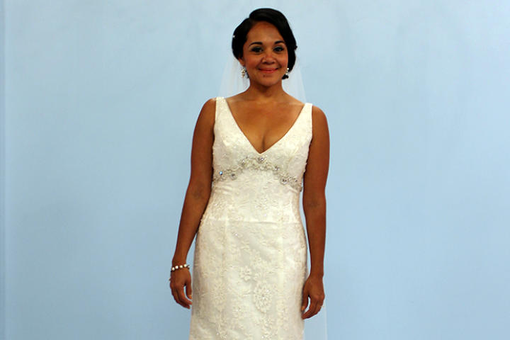 Karina, a 35-year-old California bride, hadn't had time to shop for a wedding dress -- she was too busy with her job and two children. When Sam found this deep V-neck, empire waist gown, she fell in love. It's a James Clifford design called Crystal Opulence, on sale for $1,250. Karina decided to wear her