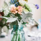 Flowers become country vintage chic when arranged effortlessly in a bl