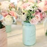 In another variation of the Mason jar vase, these are painted pretty p