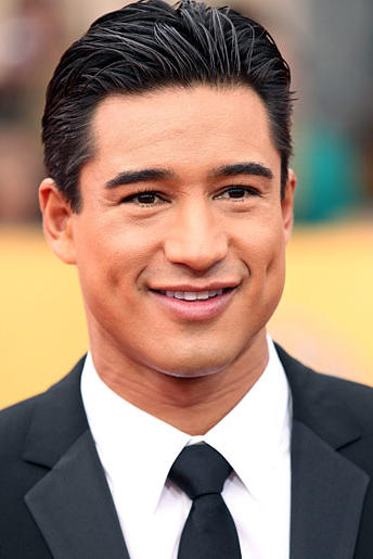 """""""Extra"""" host Mario Lopez popped the question to Courtney Mazza with the blinding aid of a 5-carat ring. He'll be sharing all the special wedding details with TLC fans when he marries in December!"""