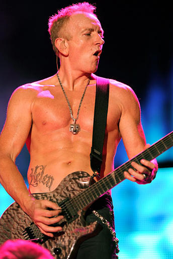 Lead guitarist in Def Leppard visits LA Ink with his fiance to get each other's name on their abdomens.