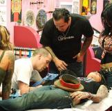 The LA Ink crew watching Steve-O tattooing Kat.