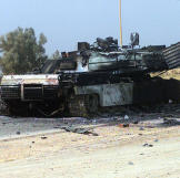 On the road to Baghdad, a US Marine Corps M1 Abrams Main Battle Tank lay destroyed after a firefight with Iraqi troops, during Operation Iraqi Freedom. Watch video of the