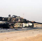 A scuttled M1A1 Abrams Main Battle Tank rests in front of a Fedayeen camp just outside of Jaman Al Juburi, Iraq during Operation Iraqi Freedom, 2003. Watch video of the