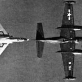 A Vought F7U-3 Cutlass of experimental squadron VX-3 gets in as close as it can to refuel from an AJ-2 Savage .