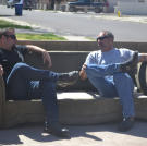 Steve Simons and Ed Rosenberg relax after a long day of inspections and bidding.
