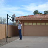 Ed Rosenberg dunks a basketball in front of his newly acquired propert