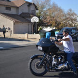 Ed Rosenberg arrives at a property auction on his motorcycle.