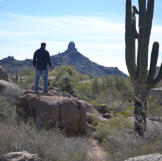Doug Hopkins checks out the scenic view from the backyard at the house at Balancing Rock.