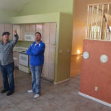 Partners John Ray and Jace Johnson inspect the interior of their newly acquired property.
