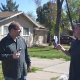 Scott Menaged and Doug Hopkins enjoy some ice cream before bidding on an auction property.