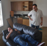 Scott Menaged lounges while Lou Amoroso looks on at a recently acquired property.