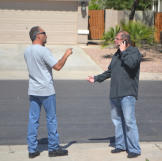 Buyers Doug Hopkins and Ed Rosenberg get into an argument while bidding on a house that's up for auction.