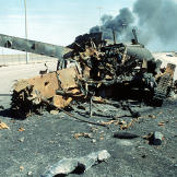 An Iraqi main battle tank on a highway south of Kuwait City destroyed in a Coalition attack during Operation Desert Storm, February 7, 1991. Watch video of the
