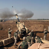 An M-198 155mm Howitzer of the US Marines firing at Fallujah, Iraq, du