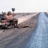 Destroyed Iraqi T-55A main battle tank lies abandoned beside a road at the edge of an oil field following Operation Desert Storm, March 1991. Watch