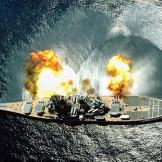 "USS Iowa (BB-61) fires a full broadside of her nine 16""/50 and si"