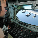 A boom operator of a KC-135 Stratotanker during an aerial refueling of a B-52 Stratofortress in Afghanistan, March 2006.
