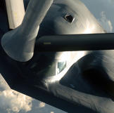 A B-2 Spirit bomber gets up close and personal with a KC-135 Stratotanker during a deployment to Andersen Air Force Base, Guam