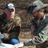 Wild Bill (left) and Willie go over plans for one of their traps.