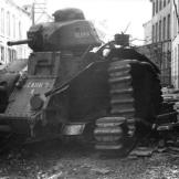 "A french ""Char B1"" tank of the 37th battalion after it has been destroyed by its own crew on May the 16th 1940, in Beaumont, Belgium. Watch video of the"