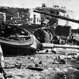 An Egyptian commando stands before a group of knocked out Israeli tanks during the Battle of Ismailia at the end of the Yom Kippur War, 1973. Watch video of