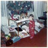 Theresa checks out the tree in an early Christmas photo.